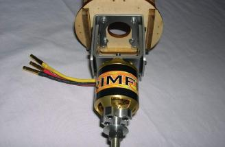 Rimfire mounted. The adjustable brushless mount slides all the way to the rearward position.