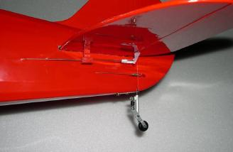 Rudder and elevator control. The manual recommends attaching the pushrod standoff to the fuselage. I chose to attach it to the stab because it put less stress on the pushrod.