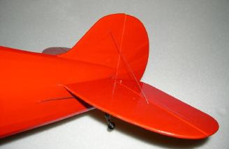 Shim gap covered with red Ultracote. Tail brace wire installed.