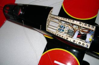 Radio components mounted. Note: If both of the flying wire springs are removed from the bottom of the airframe, the entire hatch can be moved back to allow easy access to the battery compartment.