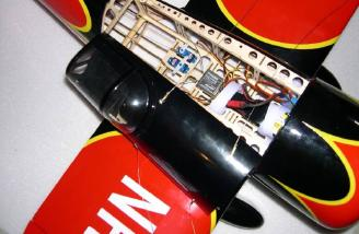 If one flying wire spring is removed from the bottom, the hatch can be moved to the side to allow access to the battery compartment.