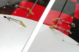 Aileron and flap control rod attachment and comparison between the two wing panels.