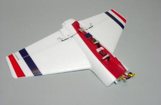 Horizontal stab with elevator and rudder servos shown as provided.