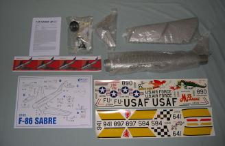 The complete kit contents, including airframe, fan, decals, and accessories.