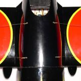 The main wing flying wires terminate at the battery hatch. They are held in place with small wood screws.