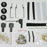 additional components including wheels (wheel bushings), fixed landing gear, carbon wing and stab spars, pushrod guides, Velcro strips and belt, fuel line for clevis retainer, and miscellaneous hardware.