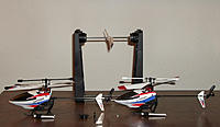 Name: 2_911_pros.jpg Views: 150 Size: 205.9 KB Description: My pair of modified v911-pros with magnetic prop balancer in the background.