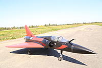 Name: IMG_2799.jpg Views: 562 Size: 621.3 KB Description: Long removable nose cone for easy transport. Removable wings and tail with screws. Aluminum landing gear with scale double nose wheel.