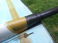 Name: 6boomrepair.jpg Views: 7 Size: 582.4 KB Description: Pod repair. Kevlar, Kevlar,Carbon,Carbon.  Strong.
