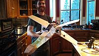 Name: IMG_20140222_165709_646.jpg Views: 126 Size: 596.0 KB Description: The prototype just before it's fateful flight. Notice the giant air brakes I used to attach the motors with and how the battery is just taped to the top.