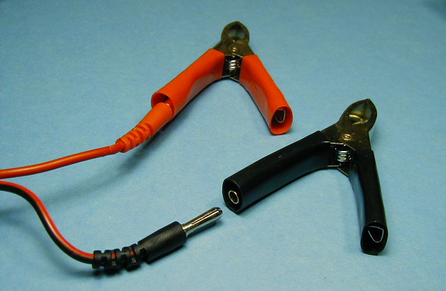 The special alligator clips supplied with one installed on the charger's input lead.