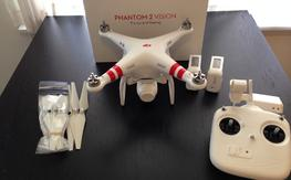 Phantom 2 Vision w/ 2 batteries, extra props, 32gb memory card