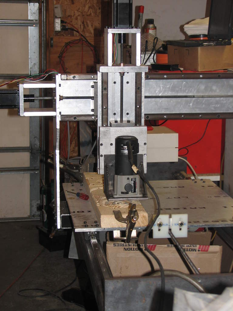 A full view of the machine while its cutting out some patterns.
