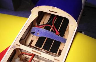 Battery tray installed and ready for action. This was made using the radio tray supplied in the kit, epoxying it in place and adding velcro strips.