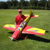 The author posing with his 27% Extra 330S.