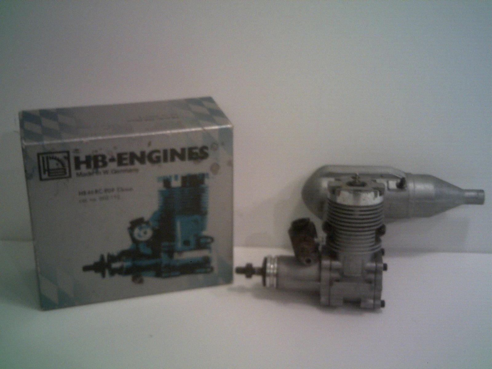 This engine comes with a perry Carb from the factory.  A great buy!