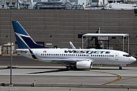 Name: _BEL4430 737-7CT C-GWBF WestJet right side taxiing l.jpg