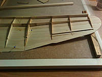 Name: Assembling Wings-02.jpg Views: 84 Size: 113.0 KB Description: Sub-spars added. Trailing edge sanded to a bevel and now gluing the other panels.