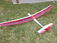 """Name: P1010733.JPG Views: 24 Size: 161.5 KB Description: Red sailplane with transparent red covering.  96"""" wing.  With spoilers that extend both above and below the wing like airbrakes.  Asking $70."""