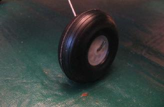"The large 2 1/2"" wheels are retained by a bend in the landing gear wire."