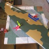 Clamps and tape hold the wing halves while the epoxy sets.