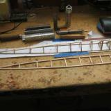 The bottom of the fuselage is built over one frame. A second stands ready for construction of the top, but where is the photo of that?  Good grief! I forgot to take it. Oh well, the next photo of the completed airframe parts will show you how things go to