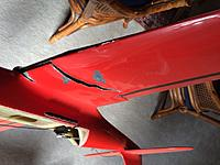 Name: Wing Damage.jpg Views: 66 Size: 148.7 KB Description: Close up of top of wing tear.