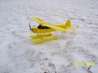 Name: piper cub on snow.jpg