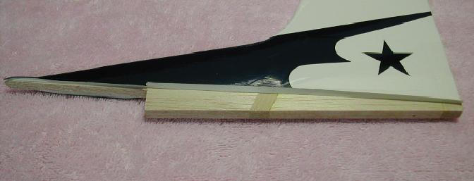 I cut the covering away and carefully peeled it back to allow for a strong epoxy joint.