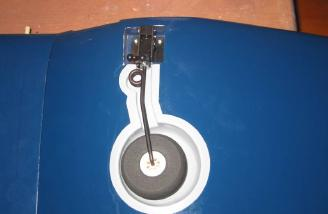 Retracts preinstalled and shown in down position with wheel well covers installed