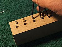 Name: jig.jpg Views: 13 Size: 92.7 KB Description: piece of wood with holes in it to solder bullet connectors.