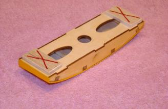 Remove balsa blocks marked with