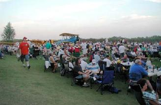 ...and just some of the crowd of folks enjoying IT'S finished product. Friday night dinner was for 1200+ folks, with more than 400 lbs of shrimp and all the bbq anyone could eat!