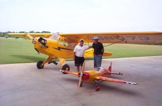 From old to new....the giant extra posed with a full size classic Cub, along with Eddie Clark and yours truly.