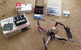 COMPLETE package- DJI f450, Naza with escs/motors, Aurora 9 radio lipo,charger...