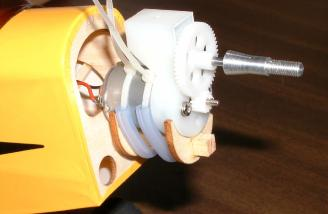 The pre-assembled motor/gearbox assembly was retained in a plywood cradle using a a pair of nylon wire ties.  The ties are sleeved with rubber tubing before fitting.