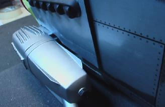 I slotted the cowling to allow the muffler to clear.