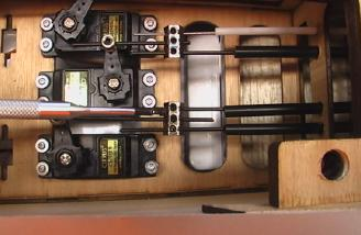 Servos are a tight fit, and you may have to turn one of them opposite the others.
