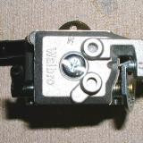 Walbro Carb and Pump : The Walbro pump carburetor makes it possible to mount the fuel tank further back, closer to the center of gravity. It could also be rotated on it's mounting block to the engine in 90 degree steps.