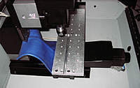 Name: Tooling plate moved to edge of table.JPG