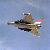 Name: F-16XL_loaded_with_500lb_bombs.jpg
