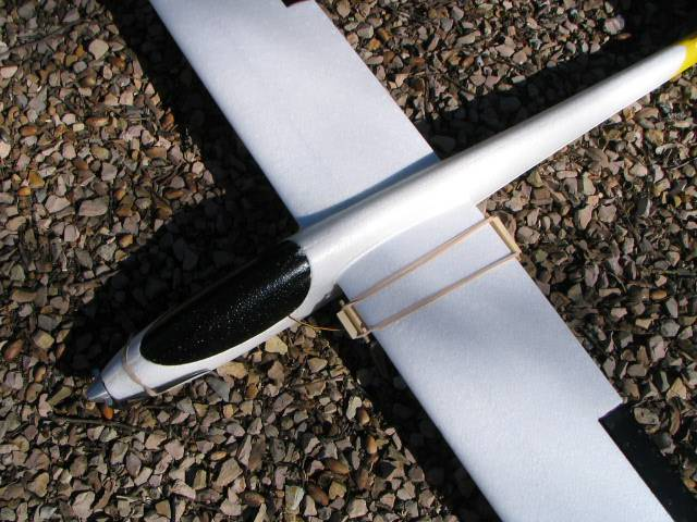 Dowels to keep bands from damaging wing