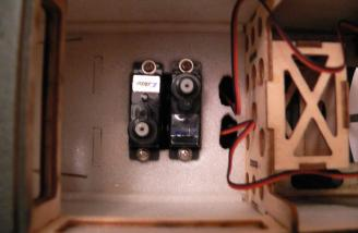 Servos mounted with wires fed through the lightening holes