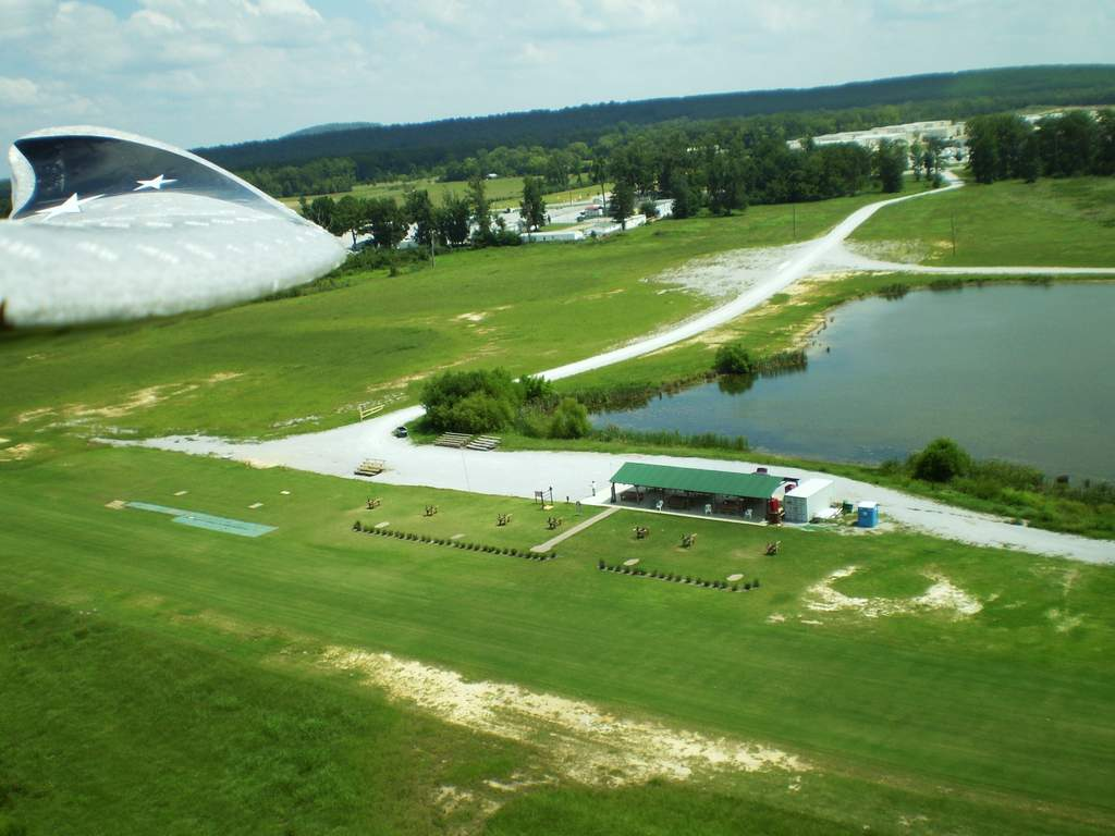From the opposite side of the field, you can see the road leading in, the covered area with the green roof and the pilots stations with bushes to separate people from planes... LOL..  