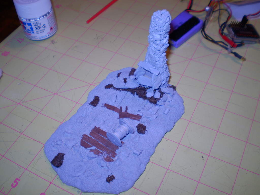 The steam tender started out like this ... the next and last in the series.  I've already primed it and painted a few of the rocks and other items.. but this one's going to be even harder.