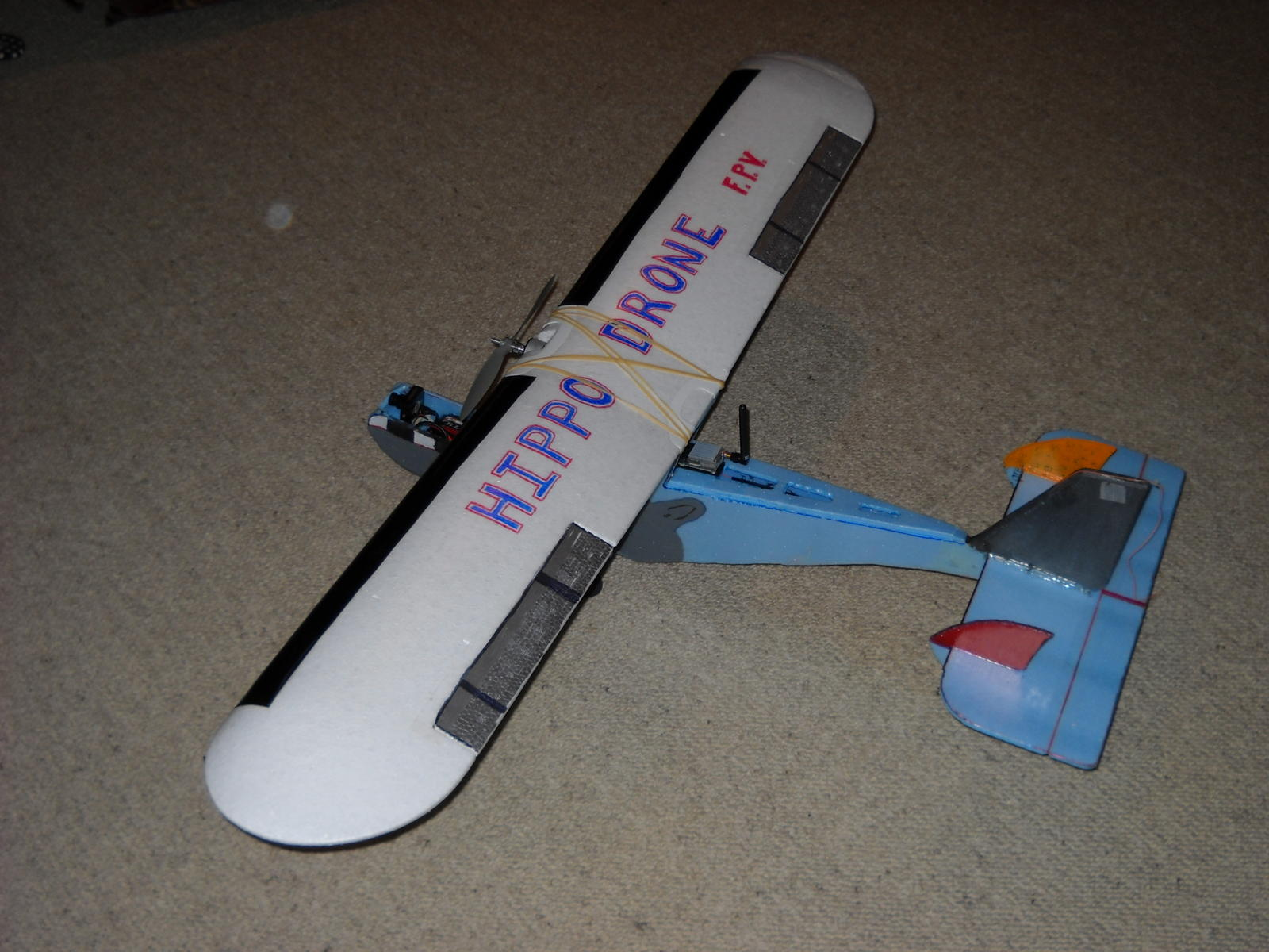 TX antenna and module just behind the wing.  Ailerons and elevator only.  Using the rudder channel to steer the front wheel.