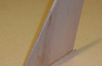 Fin with doublers attached to the rear portion of the base.