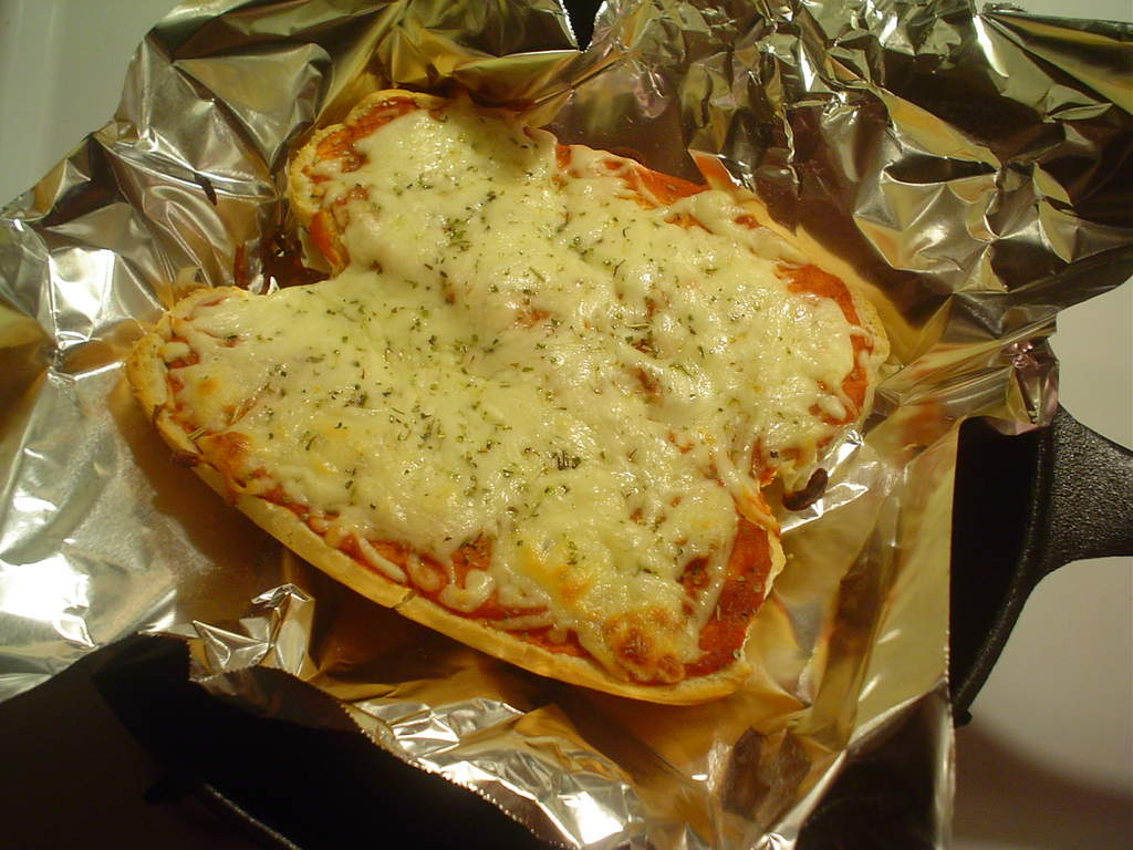 Quick and easy variation of pizza,a lot faster than making dough.