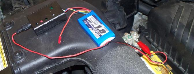 The supplied battery and charger shown here under the hood of my wife's car.