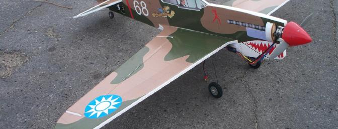 Beauty shot of the P-40 prior to its maiden flight.  I'm pleased to say it still looks pretty much the same today with the exception of the spinner and a change from wooden wheel collars to off-the-shelf metal collars.
